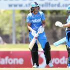 Suzie Bates (left) celebrates her century with Bridget Patterson in Adelaide. Photo: Getty Images