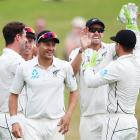 Black Caps bowlers celebrate during the second day of the second test at Hamilton. Photo: Getty...