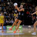 Gina Crampton looks to pass for the Silver Ferns against Australia. Photo: Getty Images