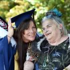 Otago Polytechnic bachelor of social services graduand Kerry Rushton celebrates a milestone with...