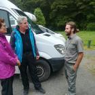 Ranger Scott Martin talks to  Dutch campers at  Purakaunui Falls  this week. Photo: Supplied