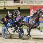 Mark Purdon salutes the Glouchester Park crowd as Lazarus wins the Interdominion Pacing Final in...