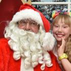 Alaya Cunningham (9) whispers her Christmas wishes to Santa in the  Meridian mall yesterday ...