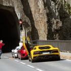 Jeremy Clarkson chats to fellow hosts Richard Hammond and James May before they enter a tunnel in...