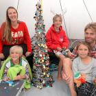 Celebrating Christmas Day in their tent at Dunedin Holiday Park are (clockwise from front left)...