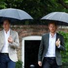 Britain's Prince William, Duke of Cambridge and Prince Harry visit the White Garden in Kensington...