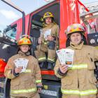 Queenstown senior firefighters, from left, Andre Freixo, Steve Gallagher and Dan Coleman are...