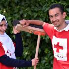 Former refugees Nada Haroura (left, 15) and Mahmoud Wees (19) are keen to help out wherever they...