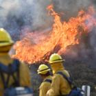 Fire fighters attack the Thomas Fire's north flank with backfires as they continue to fight a...