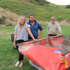 Farmers Chris Pemberton (centre), his father Rod Pemberton and his partner Jaimee Coulter, have...