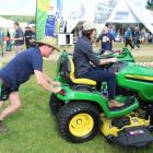 Kent Mackenzie pushes former Southland Farm Machinery group marketing co-ordinator Steph Munro as...