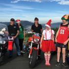 Bronz Otago Motorcycle Club president A.J. Todd (left) and fellow annual toy run participants ...