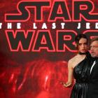 Actors Daisy Ridley and Mark Hamill pose for photographers as they arrive for the European...