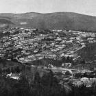 The sunny township of Opoho, North-east Valley: view from Dalmore, showing Knox College on the...