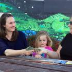 Taieri Times 10 co-ordinator Elizabeth Dalton (left), watched by her daughter, Esme Dalton (4),...