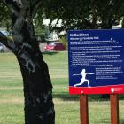 QLDC hopes signs will deter slackliners from using young trees in Wanaka's Pembroke Park. Photo:...