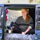 Svenja Kroell,  of Germany, relaxes in her van yesterday at the Waiora Scout Camp before the...