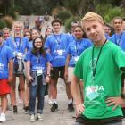 University of Otago genetics graduate Sean Driver yesterday helps senior secondary school pupils...