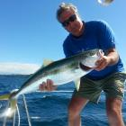 Karitane commercial fisherman Allan Anderson with one of many kingfish he has caught off the...