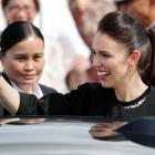 New Zealand's Prime Minister Jacinda Ardern waves to student dancers (not pictured) upon her...