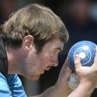 Ryan Burnett lines up the jack during men's singles play in the national championships at the...