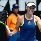 Caroline Wozniacki celebrates her quarterfinal win last night at the Australian Open. Photo:...