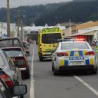 Police inspect the site of a crash, believed to have involved  a kart hitting  a parked car, in...
