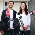 Prime Minister Jacinda Ardern and partner Clarke Gayford speak to the media after announcing they...
