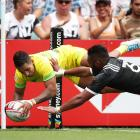 Maurice Longbottom of Australia beats Vilimoni Kordi of New Zealand to score in the corner in the...