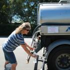 Sarah McKinlay, of Gore, fills up a bottle from a water tanker in Eccles St yesterday. The Gore...
