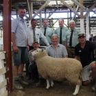 Surrounding the top-priced ram at this week's Gore ram fair are (from left, back) buyers Matt...