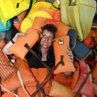 Richard Warrington, of Read Marine Ltd, Dunedin, with some of the old life jackets which have...