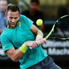 Michael Venus plays a backhand during his first round loss last night at the ASB Classic. Photo:...