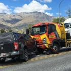 Glen Collins' tow truck was bumped into a stationary Holden Colorado after a tourist driver...