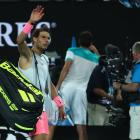Rafael Nadal waves to the crowd after withdrawing from his Australian Open quarterfinal against...