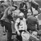 The battle of Broodseynde: R.A.M.C. men dressing wounds for prisoners, who are treated similarly...