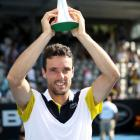 Roberto Bautista Agut of Spain poses with the trophy following his Mens Singles Final win over...