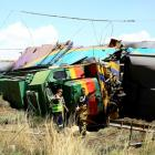 Workers stand next to a wreckage after a train crash near Hennenman in the Free State province....