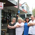Jennenne Mackie, April Elliott and Mark LeNeveu say the bus stop at 17 North Rd needs to be moved...