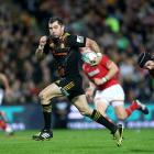 Stephen Donald makes a break for the Chiefs. Photo: Getty Images