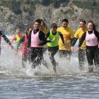 Fouad Ghanam (middle, pink bib) leads a pack of water-smart teenagers as they run down Warrington...