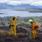 Gore Volunteer Fire Brigade officers Joe Natuikata (left) and Johnathon Moate dig up and...