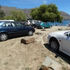 Cars park on grassy areas along Wanaka's lakefront over the New Year period. Photo: Kerrie...