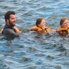 As part of their water safety programme, Swimsation instructor Ben Harrison and (from left)...