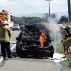 Fire crews were called after this car went up in flames near Oamaru today. Photo Daniel Birchfield
