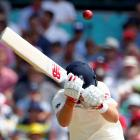 England's captain Joe Root avoids a short delivery from Australia's Josh Hazlewood during the...
