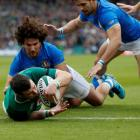 Robbie Henshaw dives over to score Ireland's first try. Photo: Reuters