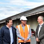 Standing in front of the Fryatt St shed where asbestos dust has been found are (from left) Stuart...