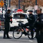 A passenger vehicle that struck a security barrier sits near the White House in Washington. Photo...