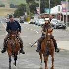 John and Ida Burgess, astride Fred and Star, practise riding through Owaka for the upcoming...